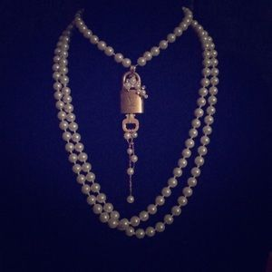 Pearl necklace w Louis Vuitton adorned Lock & Key